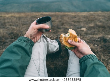 Traveler man have lunch on nature. Point of view shot - stock photo