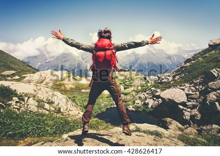 Traveler Man with backpack jumping hands raised mountains landscape on background Lifestyle Travel happy emotions success concept summer vacations outdoor