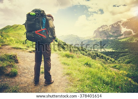 Traveler Man with backpack mountaineering Travel Lifestyle concept mountains on background Summer journey vacations outdoor - stock photo