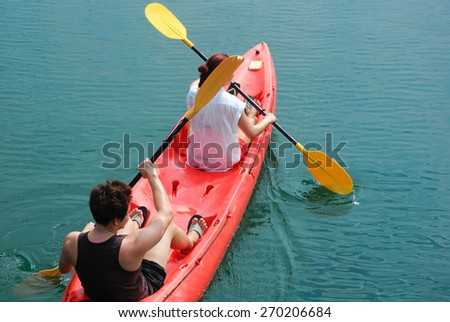 Traveler paddle a kayak on the sea. Kayaking on island - stock photo