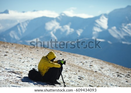Traveler photographs the landscape in the mountains. Republic of Ingushetia.