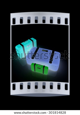 Traveler's suitcases. Family travel concept. The film strip
