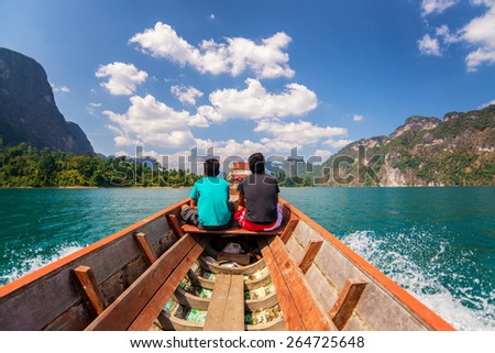 Traveler sighseeing of beautiful view mountain lake and river in Ratchaprapa dam , Khoa sok national park , Surat thani ,Thailand - stock photo
