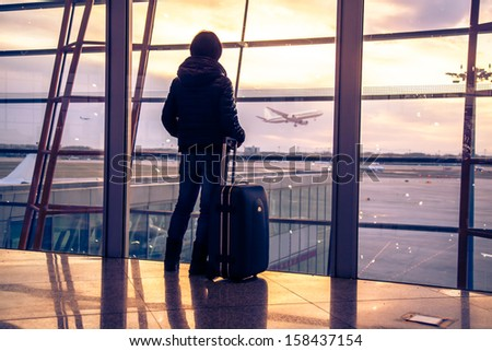 Traveler silhouettes at airport,Beijing - stock photo