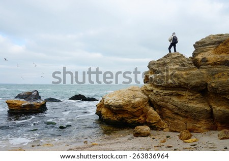 Traveler standing on the top of limestone rock,Odessa,Black Sea,Ukraine
