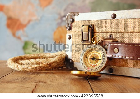 traveler vintage luggage and compass on wooden table. explorer and adventure concept  - stock photo