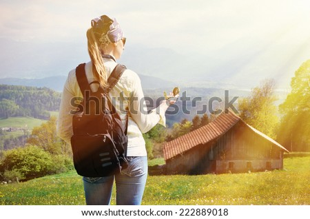 Traveler with a compass in the hand - stock photo