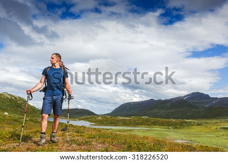 Traveler with backpack and mountain panorama  - stock photo