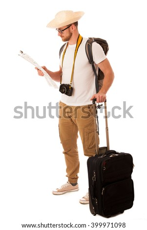 Traveler with straw hat, white shirt, backpack and suitcase waiting for transport isolated.