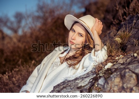 Traveler woman in the hat at nature - stock photo