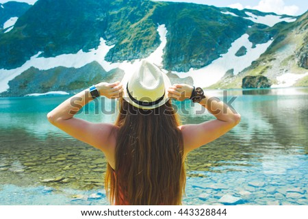 Traveler woman relaxing alone Travel Lifestyle concept lake and mountains sunny landscape on background outdoor