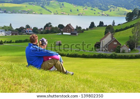 Travelers having rest on the hill - stock photo