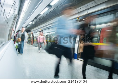 Travelers movement in tube train station, London