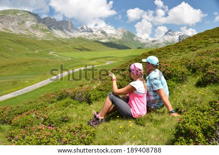 Travelers on the hill. Melchsee-Frutt, Switzerland  - stock photo