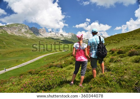 Travelers on the hill. Melchsee-Frutt, Switzerland