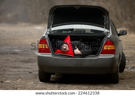 Travelers waiting for assistance in a broken car - stock photo