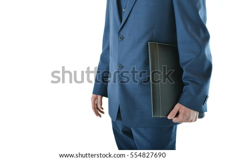 Traveling business man standing with a portfolio