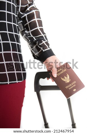 Traveling businessman handing passport - airport security concept.  Image of a persons hand holding a passport. Separate the white background - stock photo