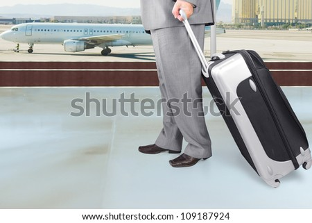 Traveling Businessman with His Luggage in the Airport - stock photo