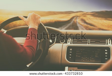 traveling by car view from the windshield at the road - stock photo