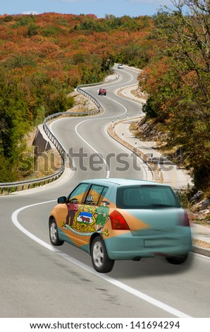 traveling car in flag of us state of delaware colors and beautiful road landscape for tourism and touristic adertising - stock photo