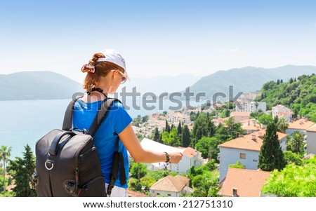 Traveling girl with map - stock photo