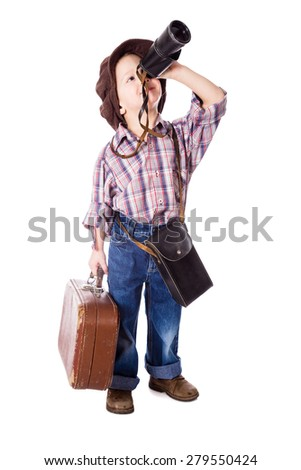 Traveling little boy with old suitcase looking to spyglass, isolated on white - stock photo