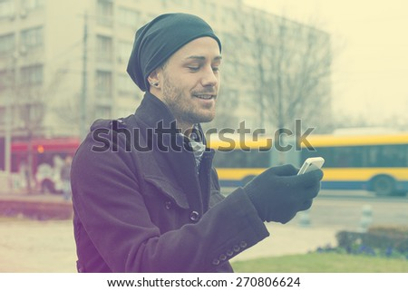 Traveling Man With Mobile Phone And Hat In City, Urban Space - stock photo