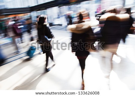 traveling people in motion blur at the railway station - stock photo