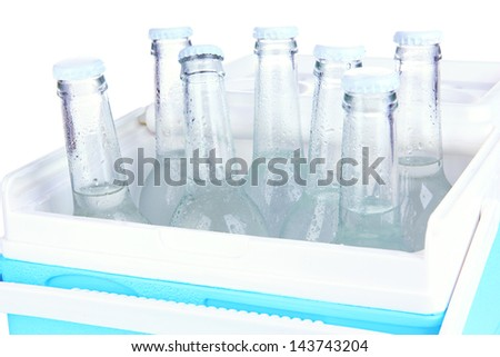 Traveling refrigerator with water bottles isolated on white - stock photo