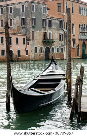 Traveling theme. Gondola on canal in Venice.