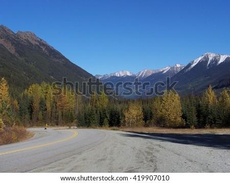 Traveling through the mountains in the autumn - stock photo