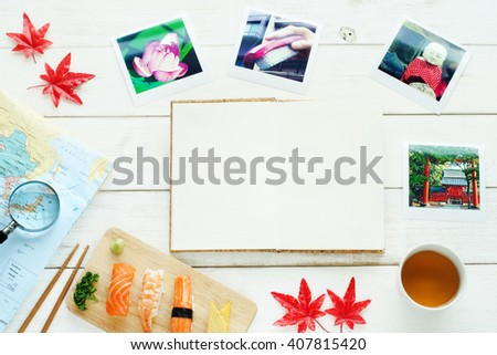 Traveling to Japan concept. Japan view travel photo, map, blank notebook, sushi, green tea, red maple leaves. Copy space. - stock photo