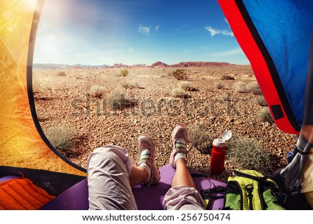 Traveling. Tourism. Tourist tent camping in desert - stock photo