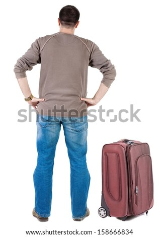 traveling young man with  suitcas . rear view. Isolated over white .