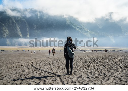 Traveller looking for a view around Bromo's area during walk back from crater.  - stock photo