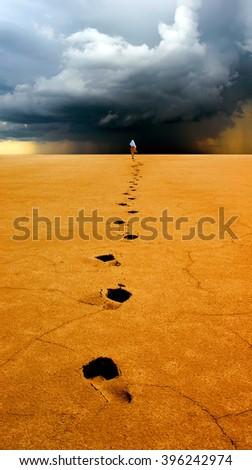 Traveller on desert. - stock photo