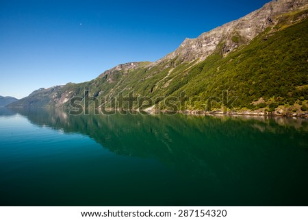 Travelling along Geiranger Fjord in Norway  - stock photo