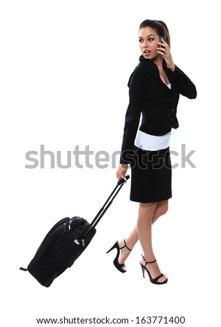 travelling business girl with luggage and smartphone