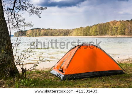 Travelling by bike alone. Womenu0027s bicycle and orange tent in the outdoors with the lake & Travelling By Bike Alone Womens Bicycle Stock Photo 411501433 ...