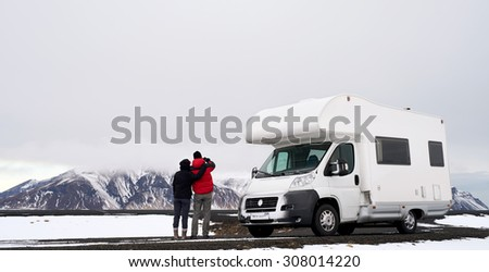Travelling couple with Mobile motor home RV campervan driving through Iceland in recreational vehicle, freedom vacation motorhome lifestyle - stock photo