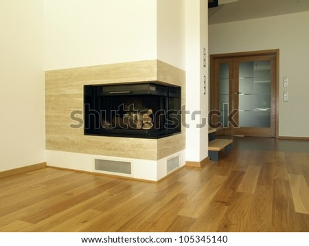 Travertine fireplace in the modern house interior - stock photo