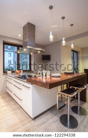Travertine house - bright kitchen with white cabinets - stock photo