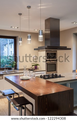 Travertine house - close up of a modern kitchen interior - stock photo