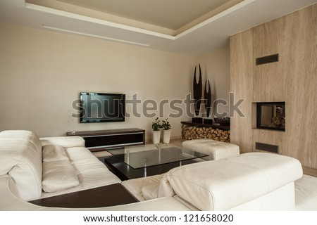Travertine house: Fashionable interior with fireplace, living room - stock photo