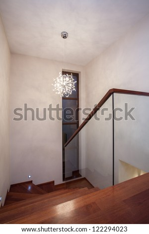 Travertine house - glass staircase with wooden stairs