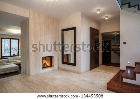 Travertine house: hallway, stairs and living room - stock photo
