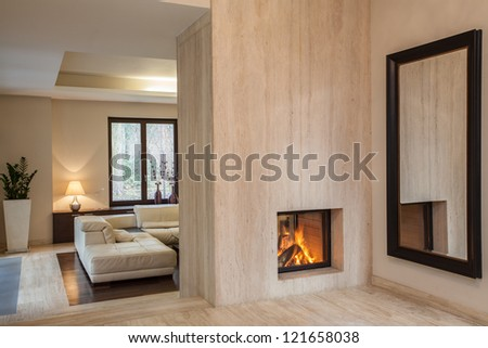 Travertine house: hallway with huge mirror - stock photo