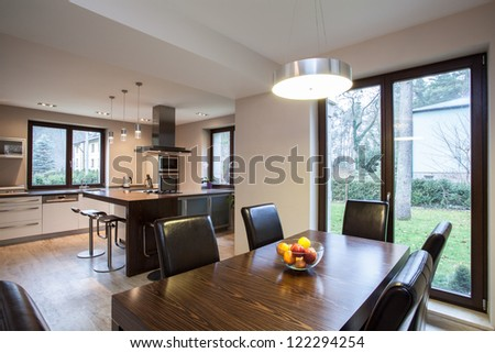Travertine house - view of a dining room and kitchen - stock photo