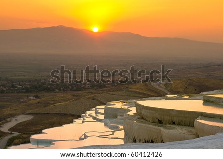 Travertine pools and terraces in Pamukkale/Turkey in sunset time